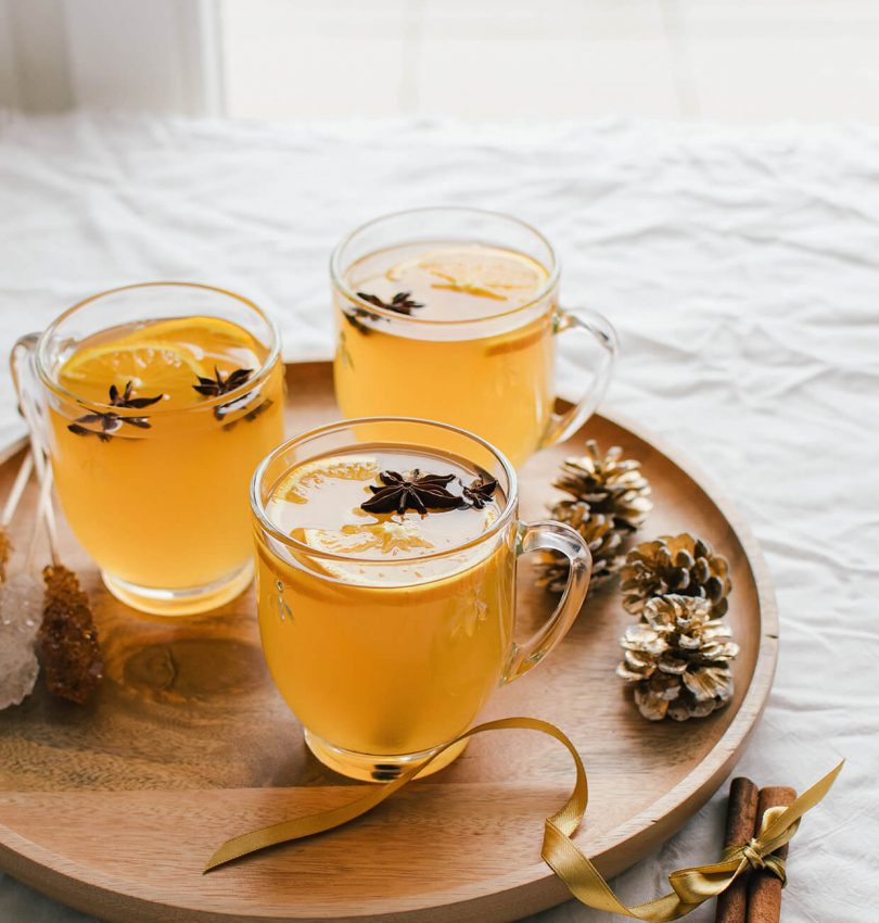 Easy and delicious mulled white wine with oranges, cinnamon, star anise and more.