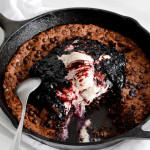 oatmeal fudgy skillet cookie blueberry sauce vanilla ice cream