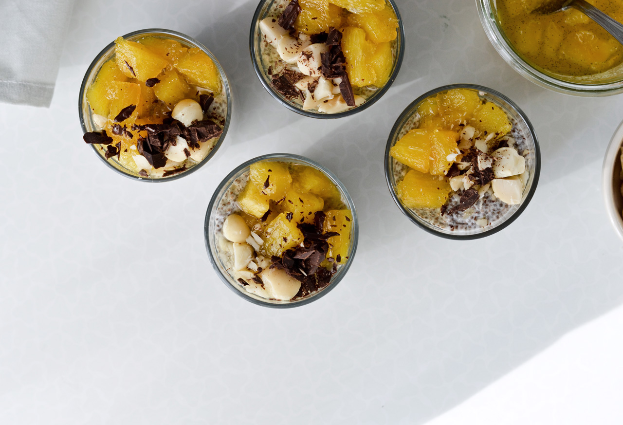 banana coconut chia pudding with pineapple, chocolate and macadamia