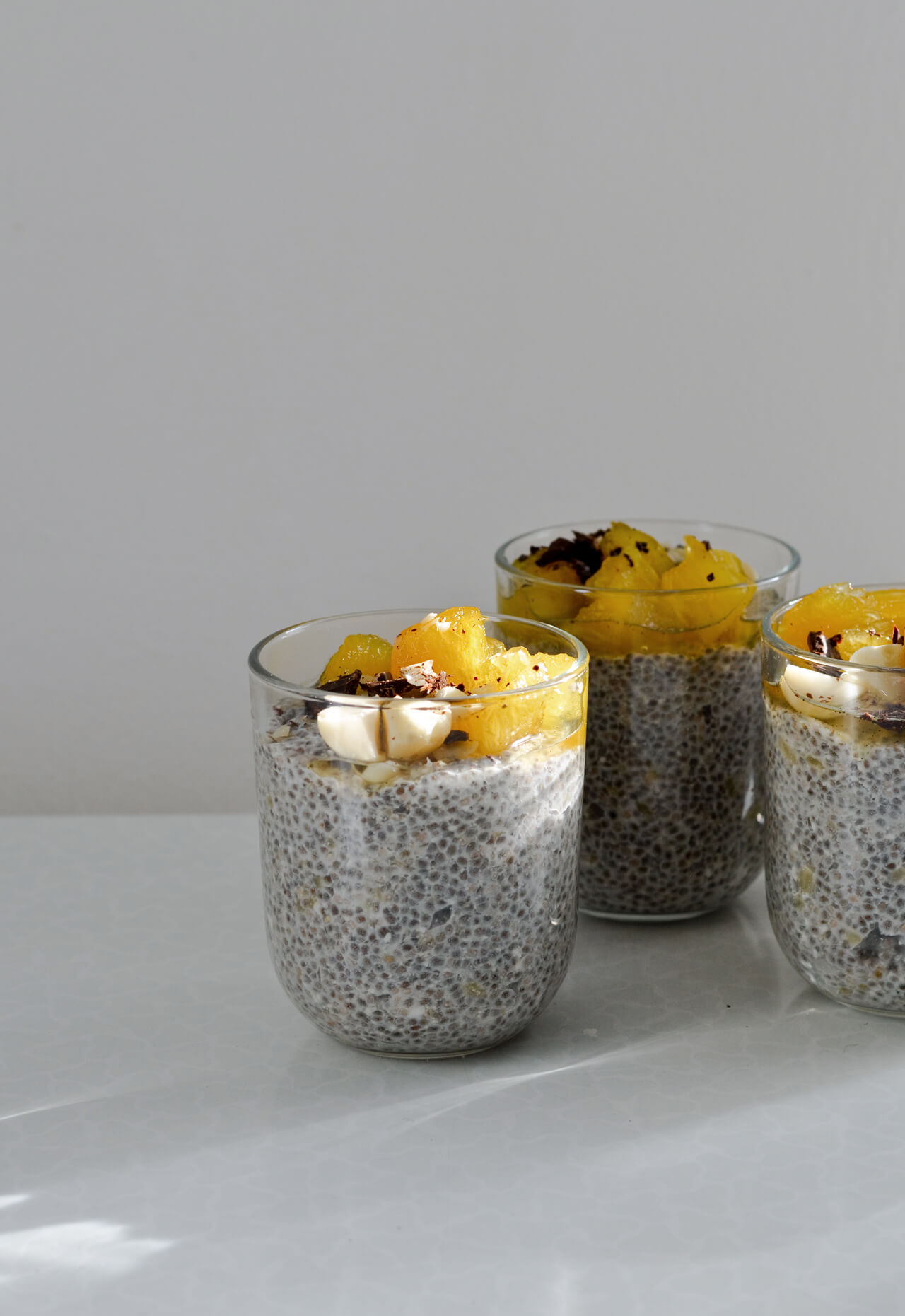 banana coconut chia pudding with pineapple, chocolate, macadamia