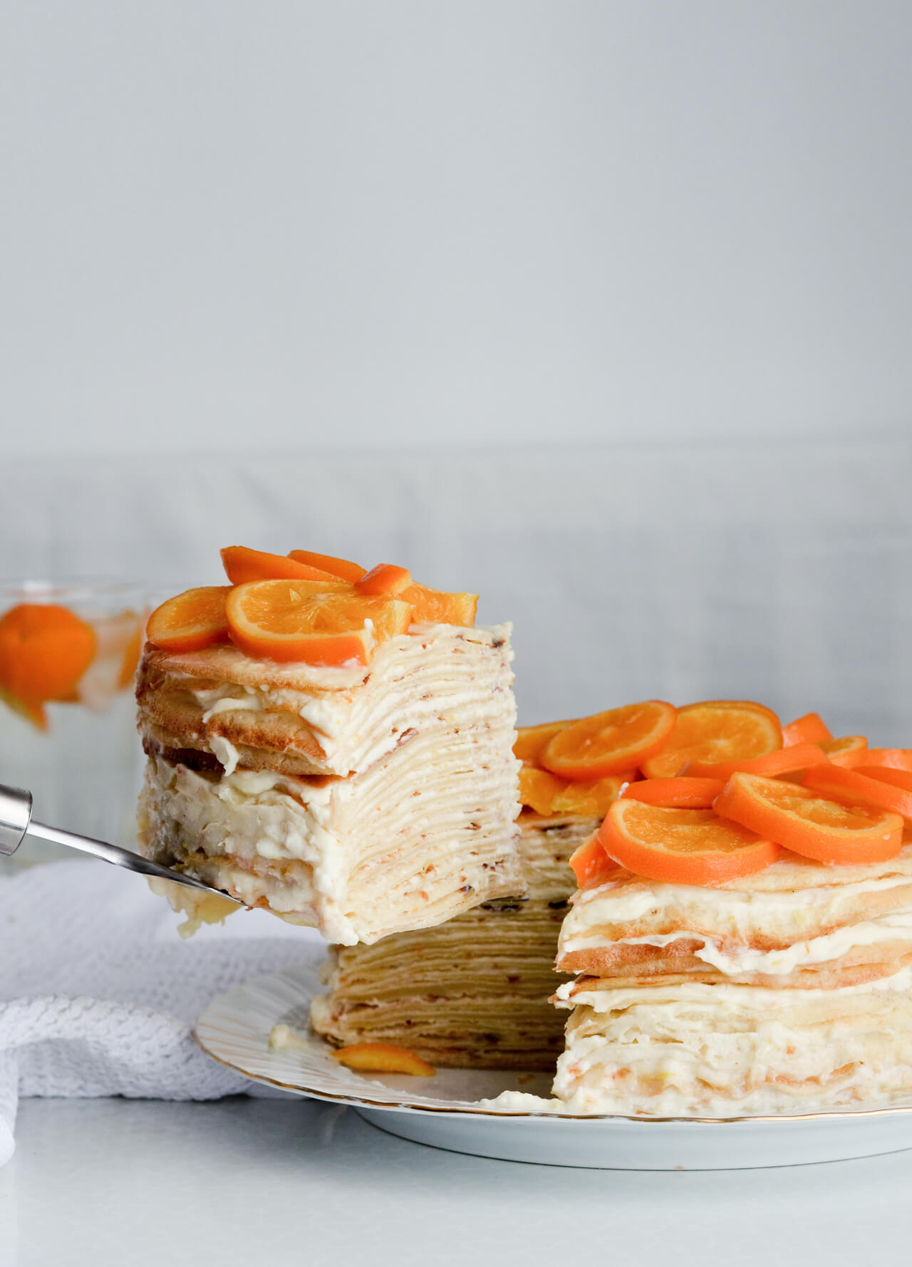 orange ricotta crepe cake - candied orange slices