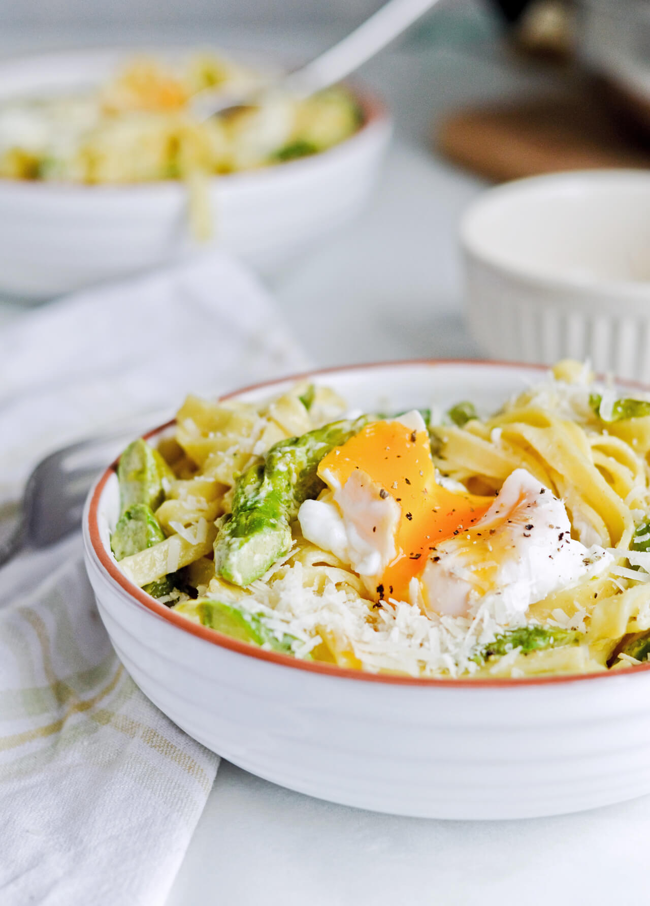 Creamy asparagus tagliatelle with poached eggs - a quick and wonderful asparagus dinner.
