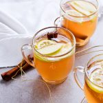 Apple mulled white wine offers a new twist on and old classic! The perfect winter drink, it's a warm mix of wine, apples and cinnamon. Great for gatherings, holiday parties or quiet weekends at home. Done in under 30 minutes! | @mitzyathome