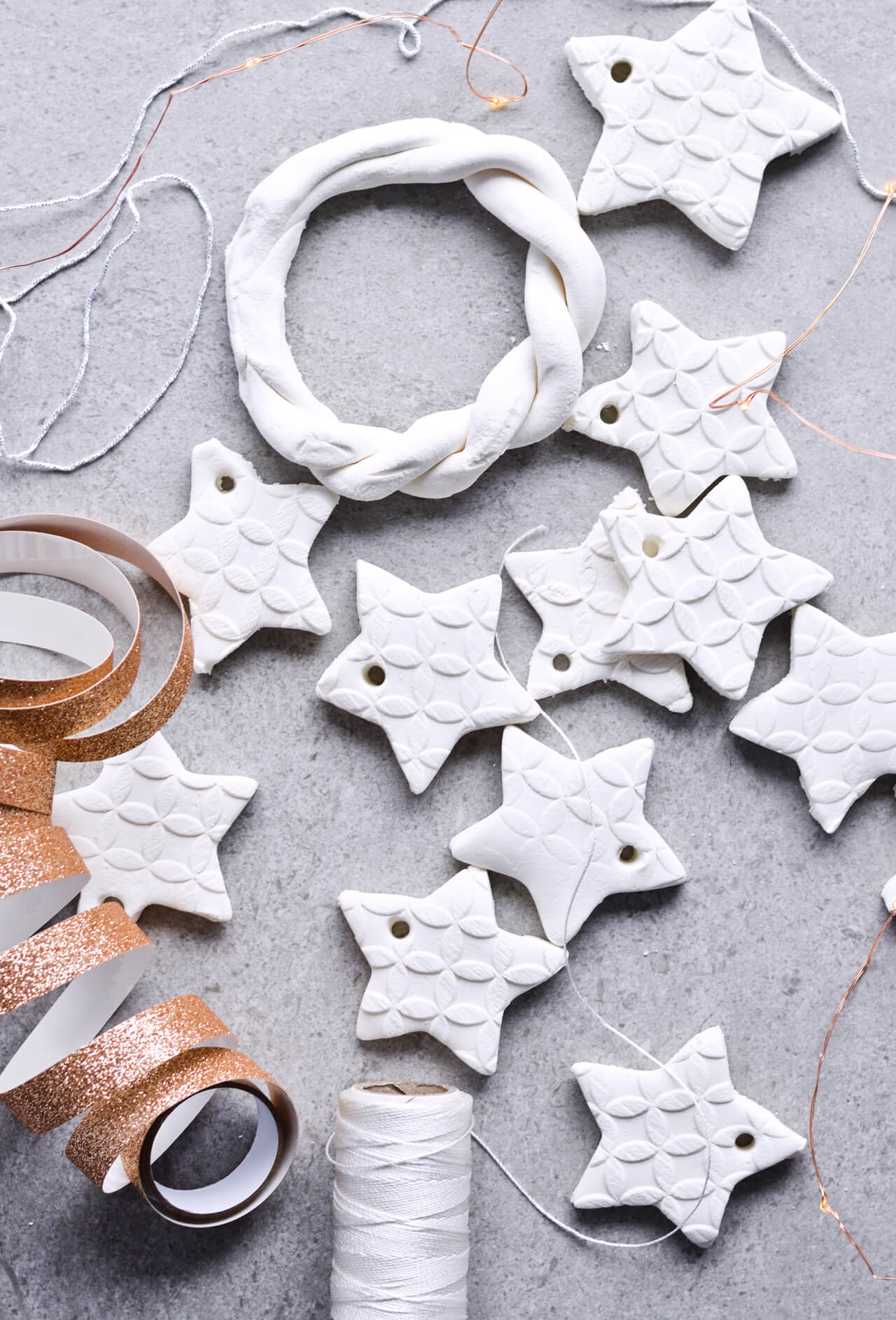 Simple tutorial for homemade scented baking soda ornaments. Easy to make, affordable ornaments that are snow-white and just the perfect personal touch for Christmas. Scented with cinnamon and orange oils! | sugarsalted.com