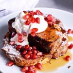 Recipe for Orange yogurt Stollen french toast. Christmas Stollen prepared as classic french toast, topped with creamy orange Greek yogurt, pomegranate seeds, maple syrup. Perfect breakfast or brunch recipe. | @mitzyathome sugarsalted.com