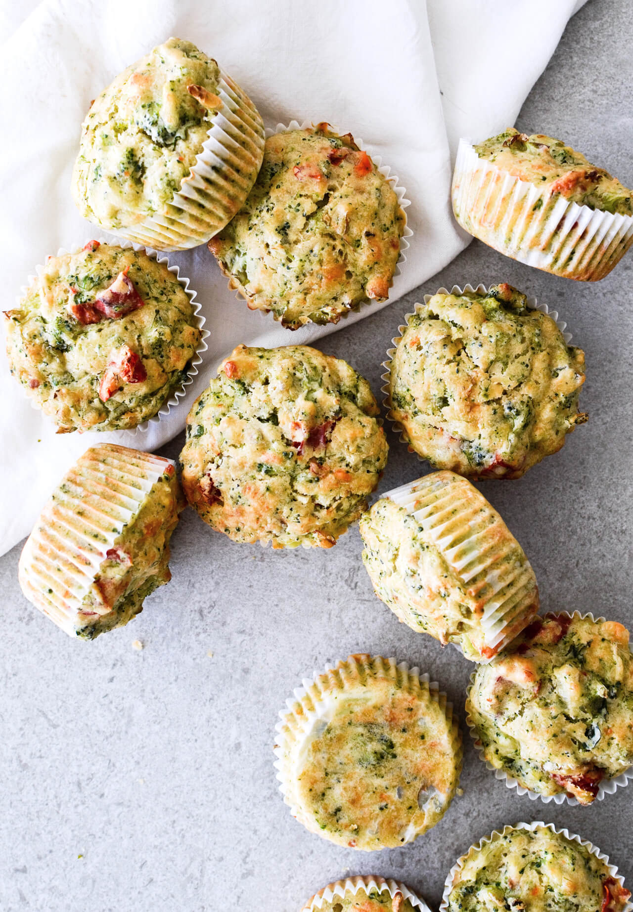 Olive oil broccoli muffins with cabbage and sun-dried tomatoes make the perfect breakfast on the go, or a side to your lunch salad or dinner meal. Great for kids too!