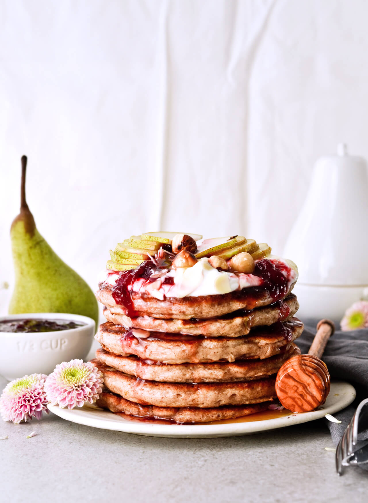 Recipe for shredded pear pancakes with yogurt and honey! Perfect Fall brunch recipe that makes fluffy, fruity pancakes everyone can enjoy.