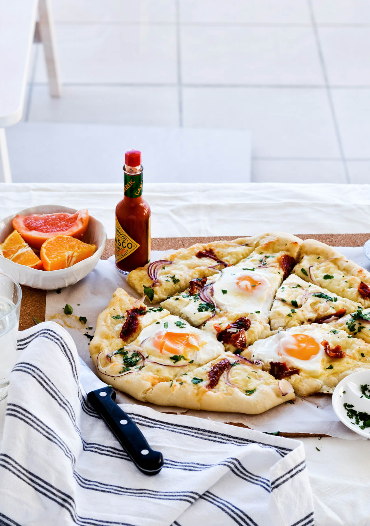 Easy sun dried tomato onion breakfast pizza with eggs, easy brunch recipe that is quickly made.