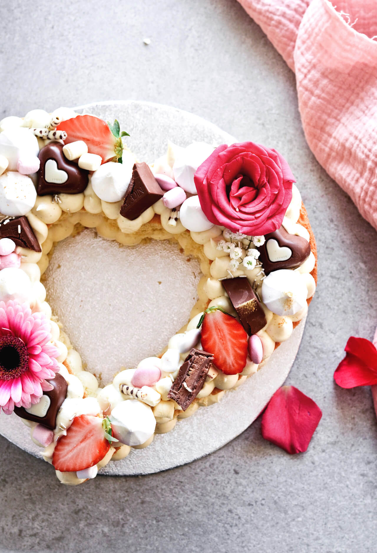 White chocolate cream cheese naked heart cake is the perfect spring or summer cake, topped with fresh berries and flowers it's eye-catching and pretty.