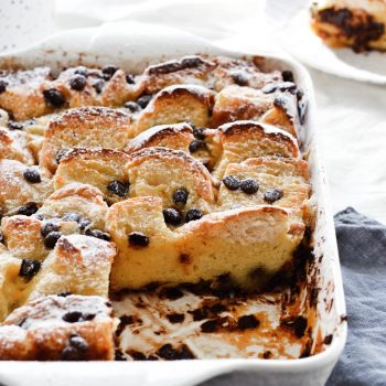 Easy to make orange chocolate chip bread pudding, made with challah and topped with whipped cream. Perfect brunch or dessert!