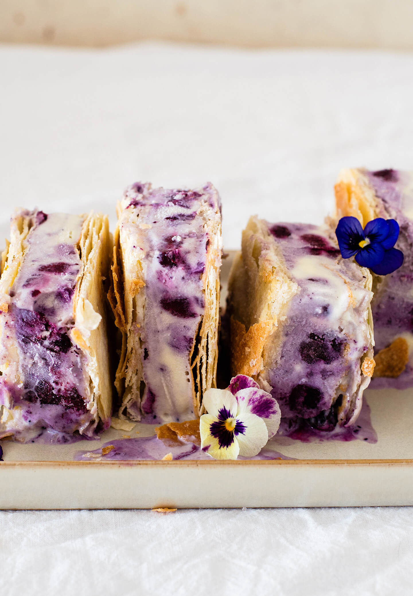 Roasted blueberry phyllo ice cream sandwiches are the perfect summer treat! Pretty to look at and tasty, filled with berries and lime sugar!