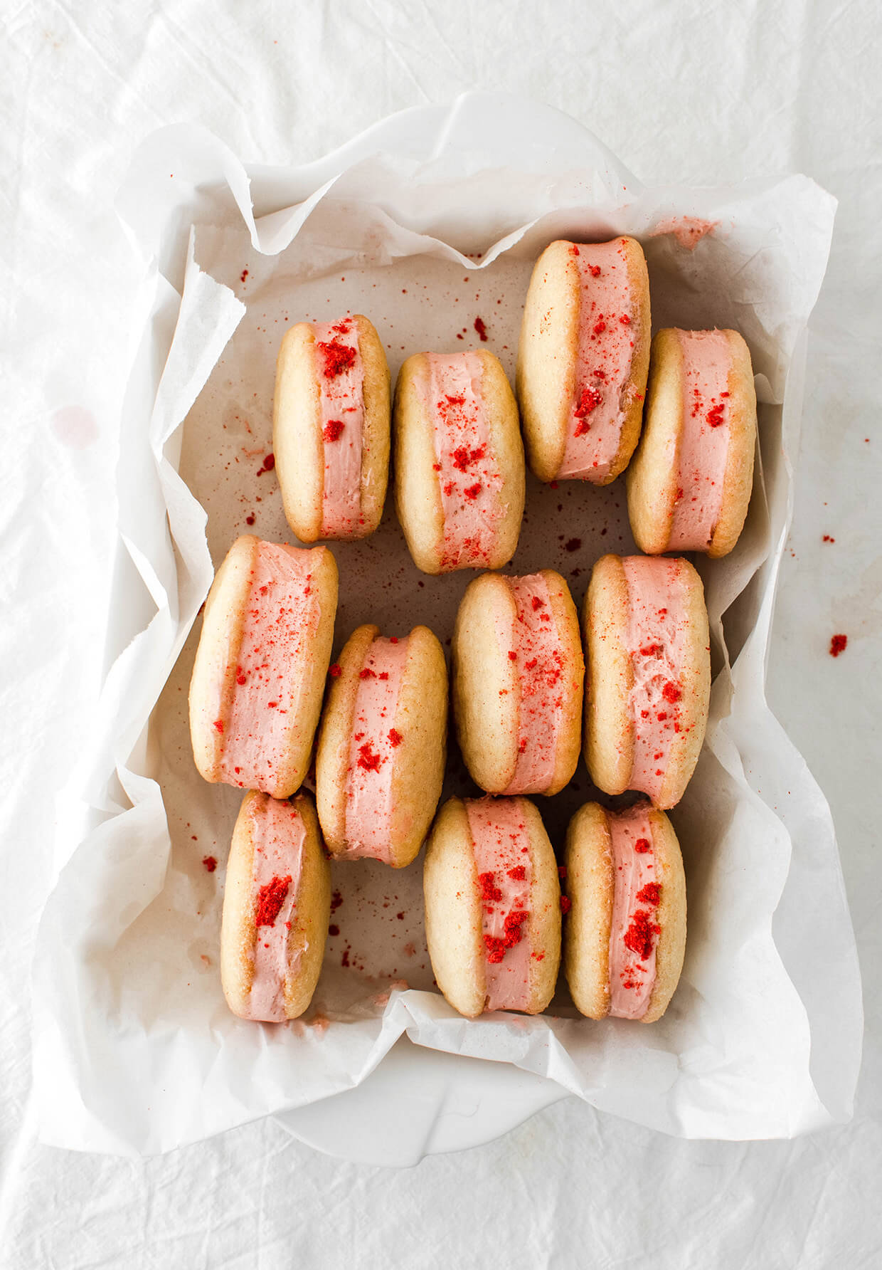 white tray of pink strawberry sandwich cookies