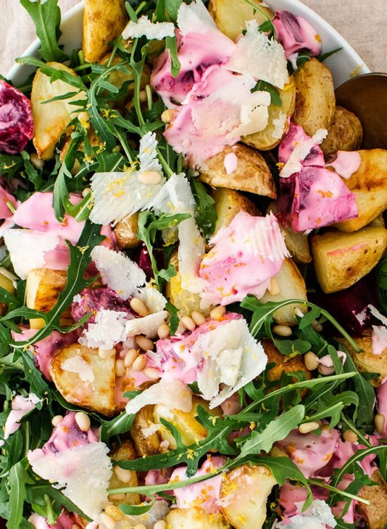 Roasted potatoes with arugula and creamy beets that will satisfy a crowd! A wholesome and simple vegetarian meal that comes together in 40 minutes!