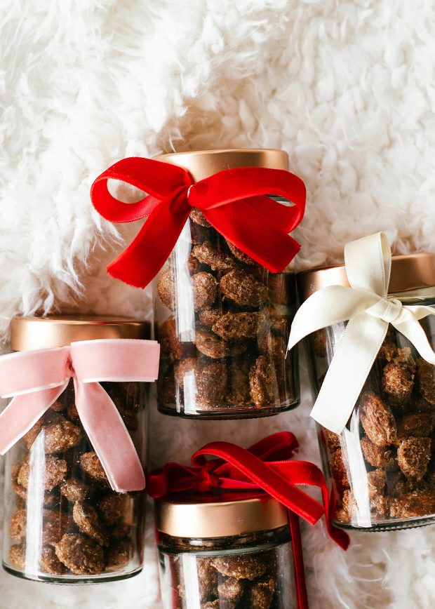 cinnamon roasted almonds in glass jars with velvet ribbon